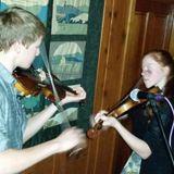 Gretal and Gustav Baur play fiddle