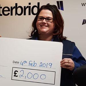 Lindsay Kennedy, Community Champion at Tesco Heswall, gives Radio Clatterbridge a £2,000 donation
