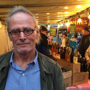 Chatting with an American in a Parisian market