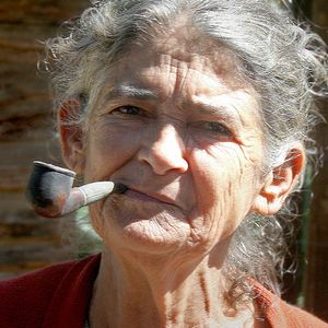 Lay at bed and smoke a pipe