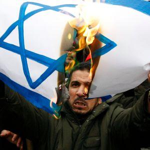 Iran Mocks the Holocaust While Terrorists Attack Israel