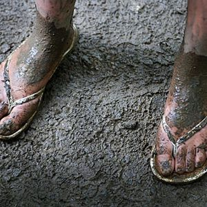 Damp proofing the muddy flipflops.